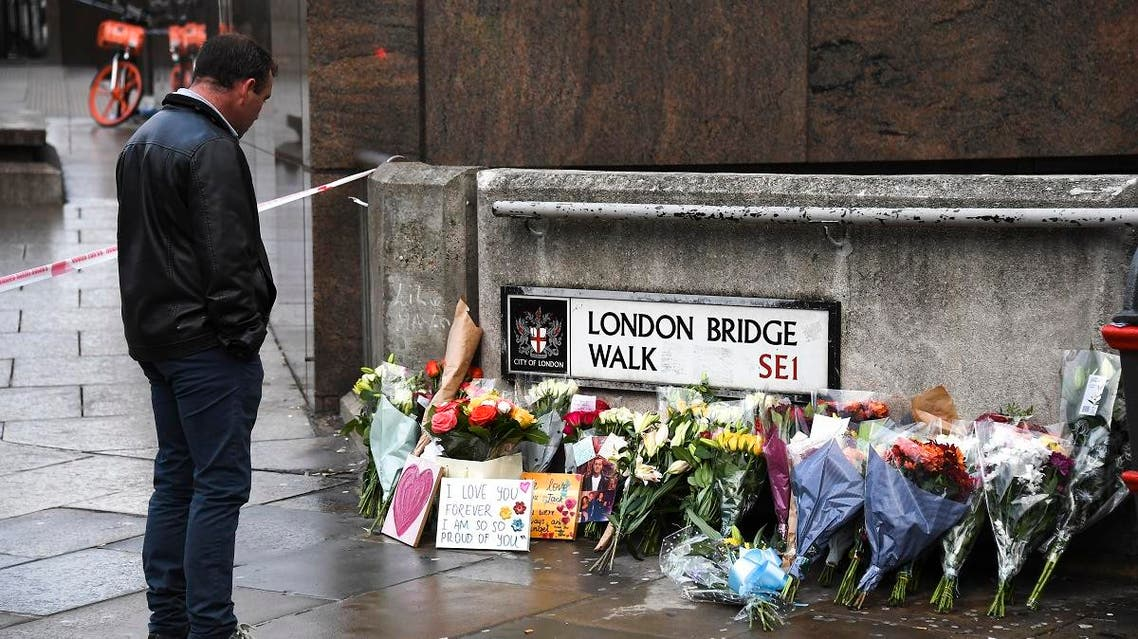 Flowers and a pictures are left in memory of Jack Merritt, who is the first victim to be named following Friday's terror attack on London Bridge in London, on December 1, 2019. (AP)