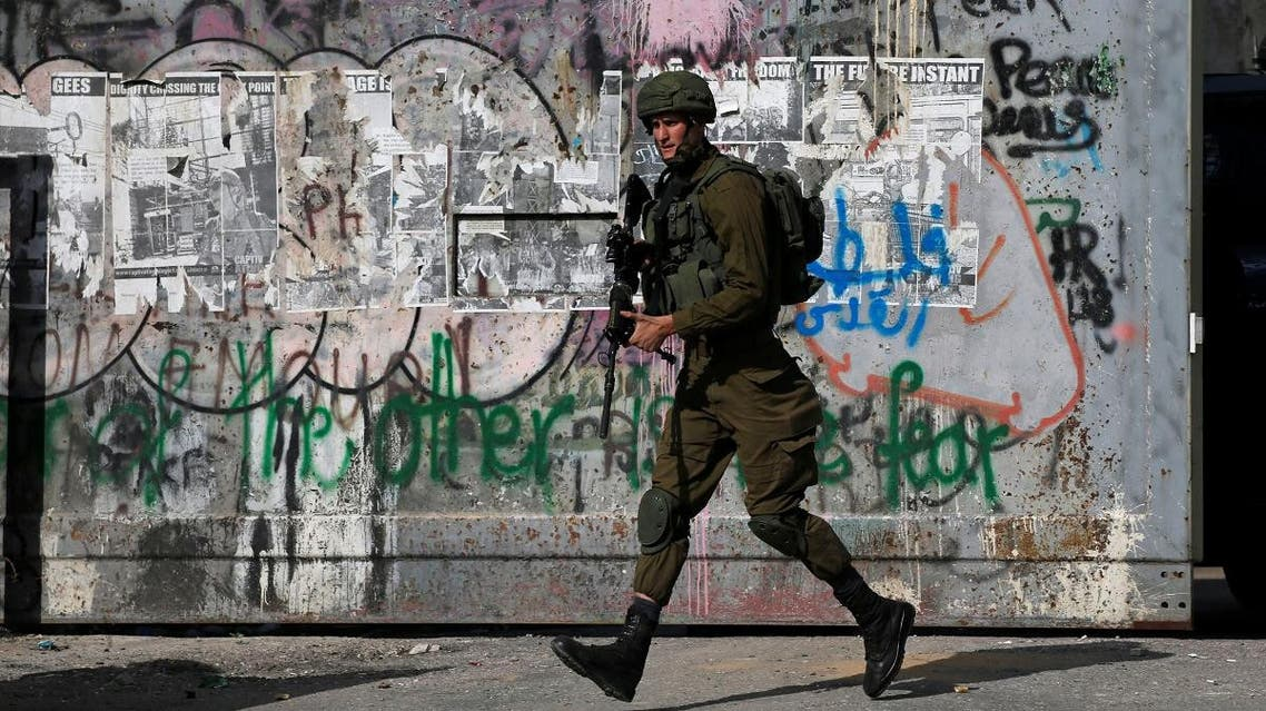Israeli soldier runs during an anti-Israel protest by Palestinians in Bethlehem, in the Israeli-occupied West Bank. (Reuters)
