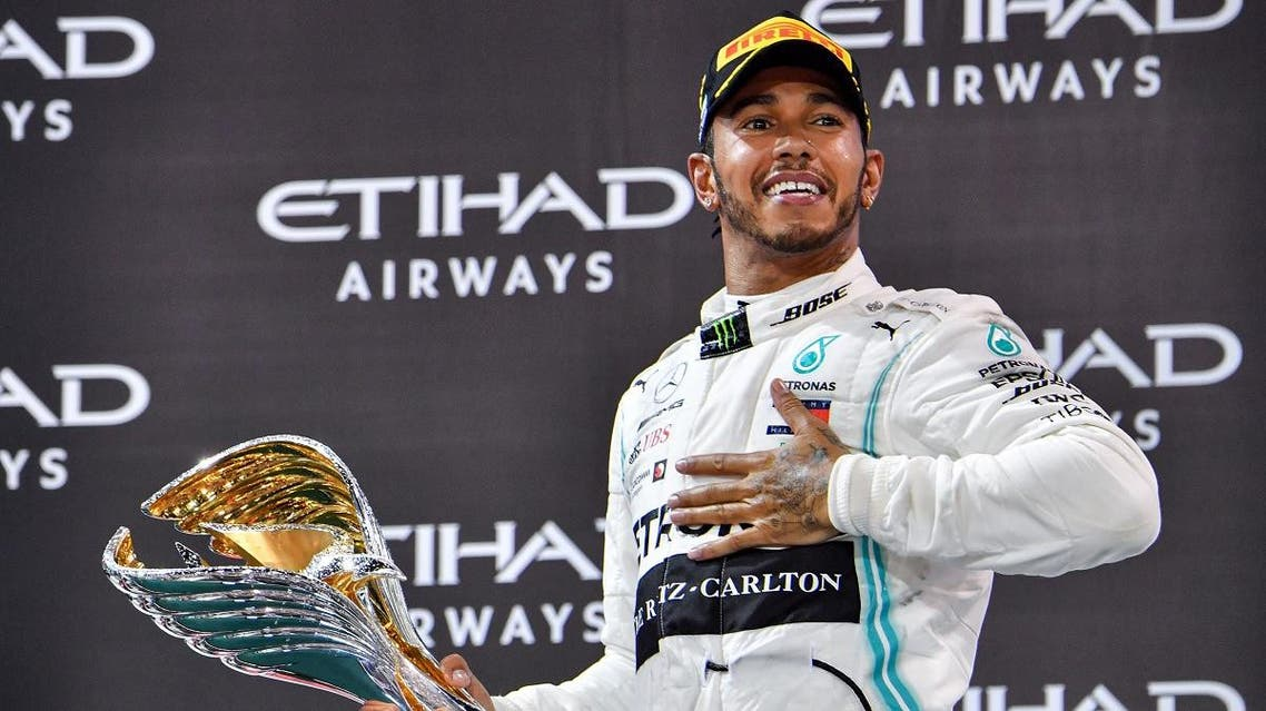 Mercedes' British driver Lewis Hamilton celebrates his win at the Yas Marina Circuit in Abu Dhabi, after the final race of the Formula One Grand Prix season, on December 1, 2019. (AFP)