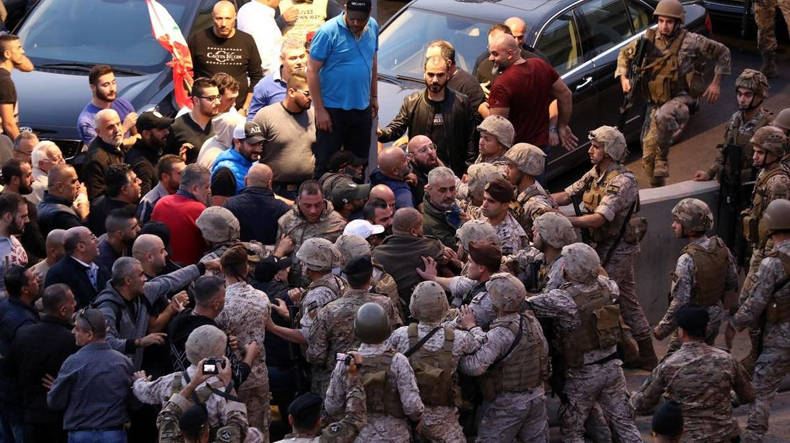 Backers of the Free Patriotic Movement founded by the Lebanese president scaffle with soldiers during a rally in his support on a road leading to the presidential palace in Baabda near the capital Beiruton December 1, 2019. (AFP)