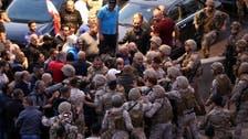 Lebanon army separates protests near Aoun's palace