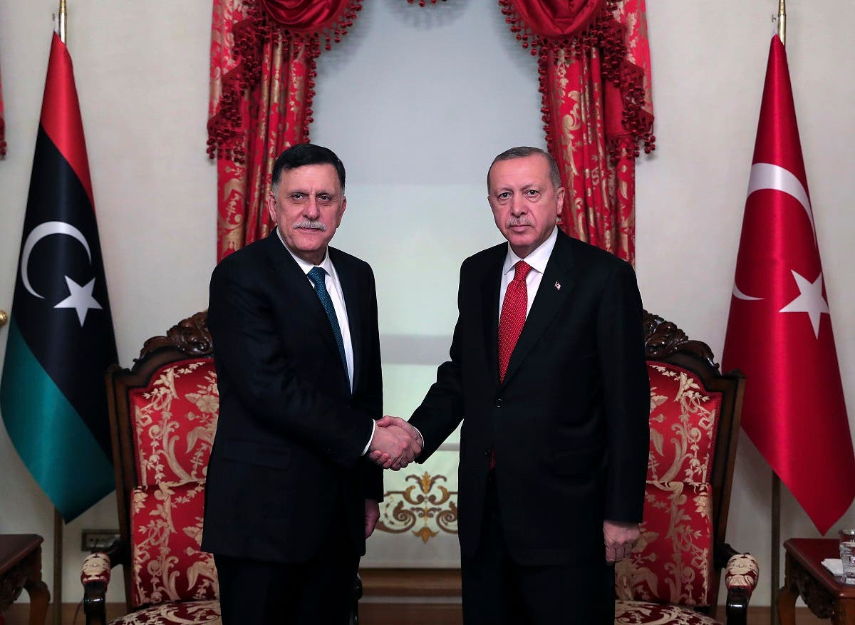 Turkey's President Recep Tayyip Erdogan, right, shakes hands with Fayez al Sarraj, left, the head of Libya's GNA, prior to their meeting in Istanbul on Nov. 27, 2019. (AP)
