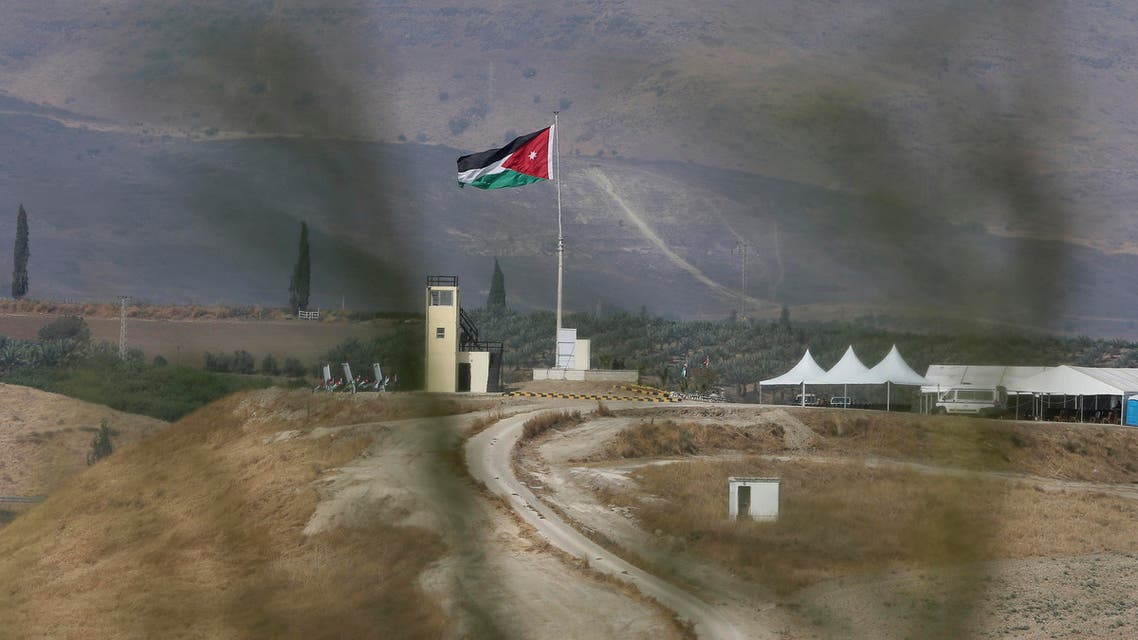 Soldiers stand guard in a watchtower flying Jordanian flags, in the area of Baqoura near the Israeli-Jordanian, border, on Wednesday, Nov. 13, 2019. (AP)