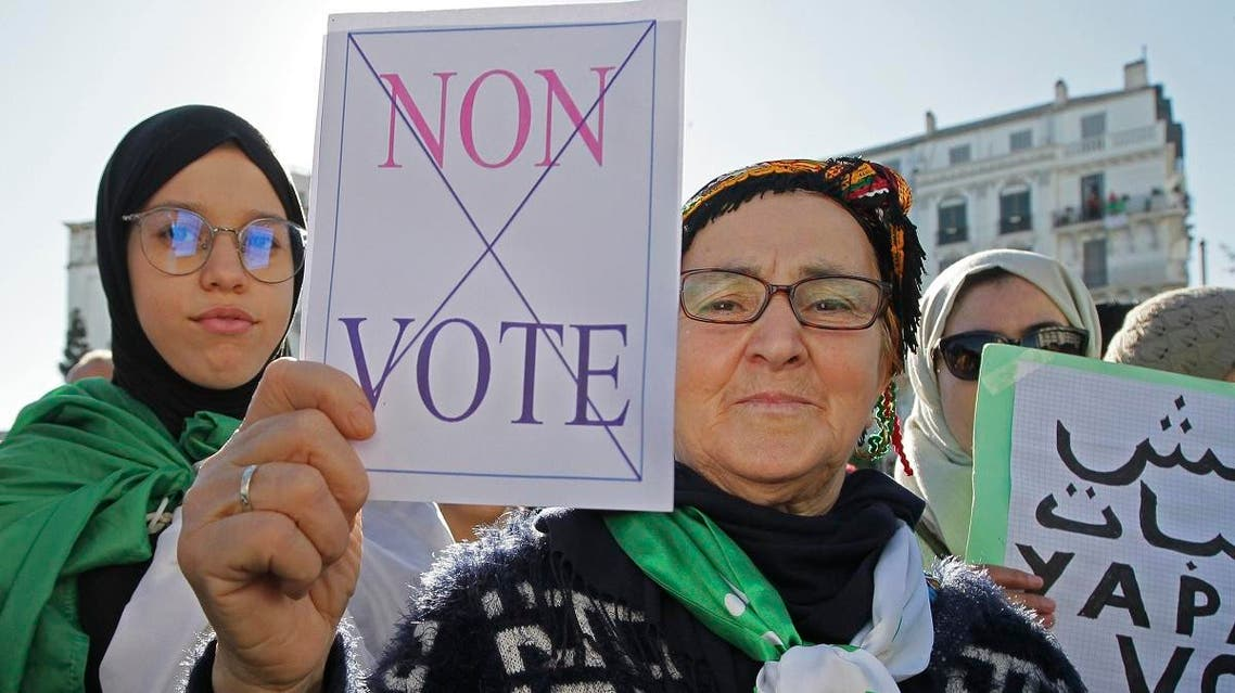 """An Algerian demonstrator holds a placard that reads """"no vote"""" during a protest against the government and the upcoming presidential elections in Algiers, Algeria, Friday, Nov.29, 2019. (AP)"""