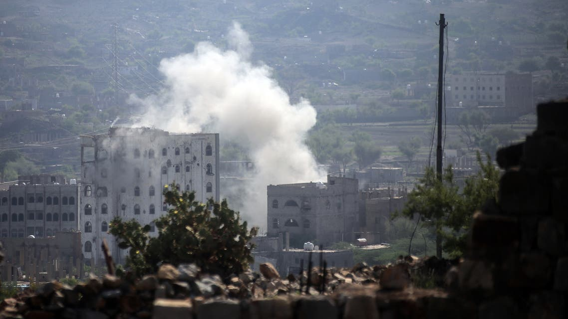 Smoke billows during clashes between fighters loyal to Yemen's Saudi-backed president and Iran-aligned Huthi rebels in the country's third-city of Taez on May 30, 2019. Taez, in southern Yemen, is under siege by the Huthis but controlled by pro-government forces, who are supported by the military coalition led by Saudi Arabia and the United Arab Emirates.