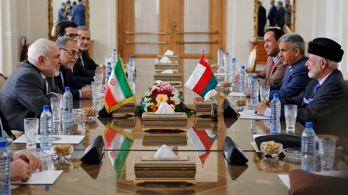 Iran's Foreign Minister Mohammad Javad Zarif (L) meets with Oman's Minister of State for Foreign Affairs Yusuf bin Alawi bin Abdullah (R) in Tehran on December 2, 2019. (AFP)