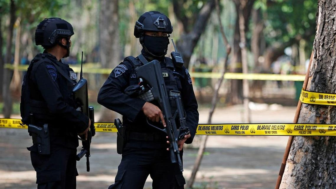 Armed police officers stand guard following a blast at National Monument (Monas) complex in Jakarta.