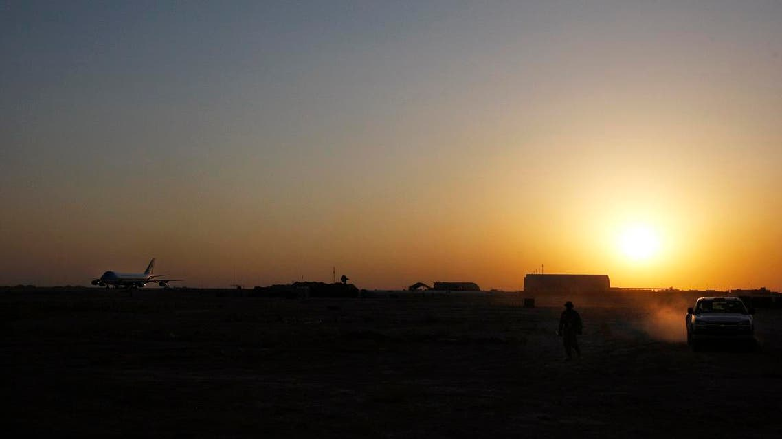 A file photo of Air Force One, left, is seen parked as the sun sets over Al-Asad Airbase in Anbar province, Iraq, Monday, Sept. 3, 2007. (AP)