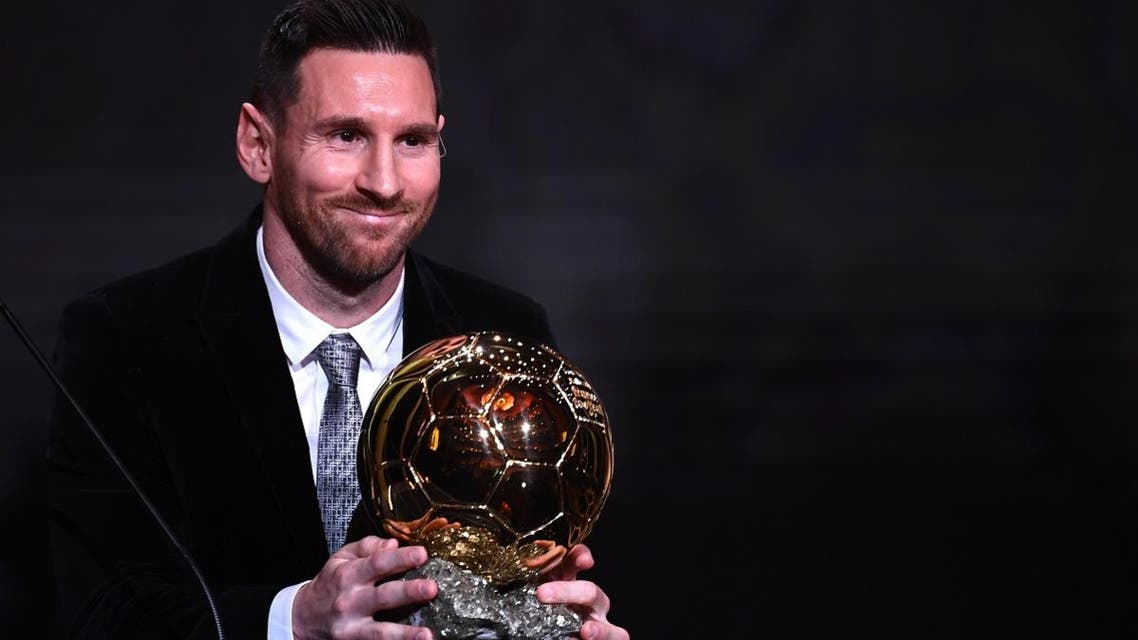 Barcelona's Argentinian forward Lionel Messi reacts after winning the Ballon d'Or France Football 2019 trophy at the Chatelet Theatre in Paris on December 2, 2019. (AFP)