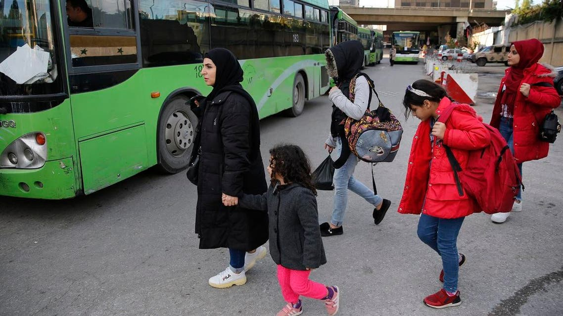 Syrian refugees prepare to board a bus to take them home to Syria, in Beirut, Lebanon, Tuesday, December 3, 2019. (AP)