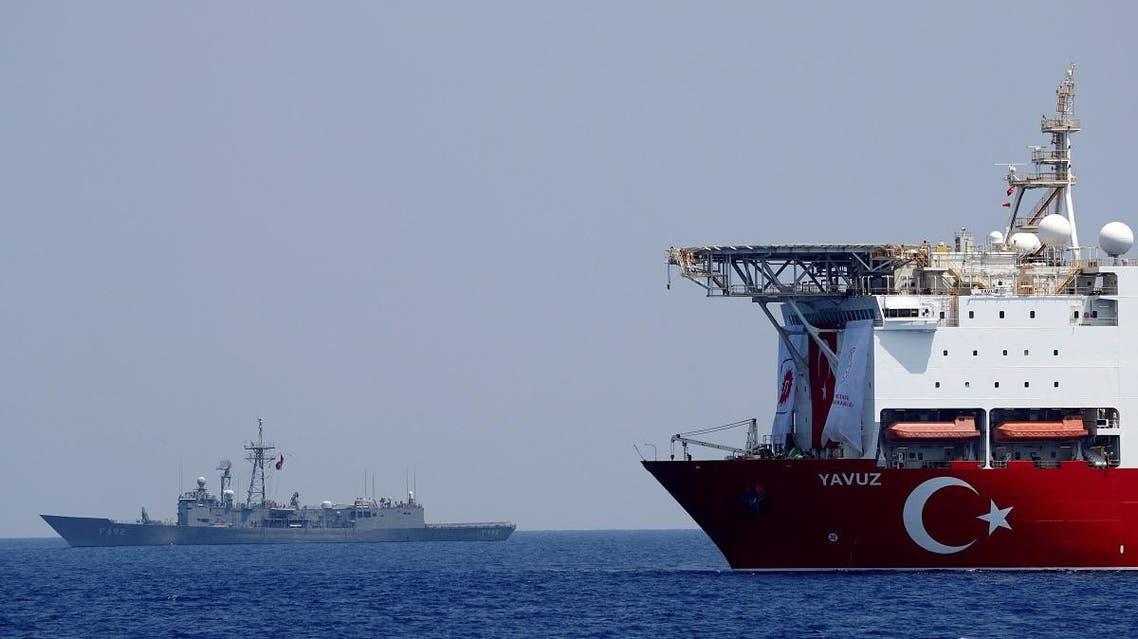 Turkish drilling vessel Yavuz is escorted by Turkish Navy frigate TCG Gemlik (F-492) in the eastern Mediterranean Sea off Cyprus, August 6, 2019. REUTERS