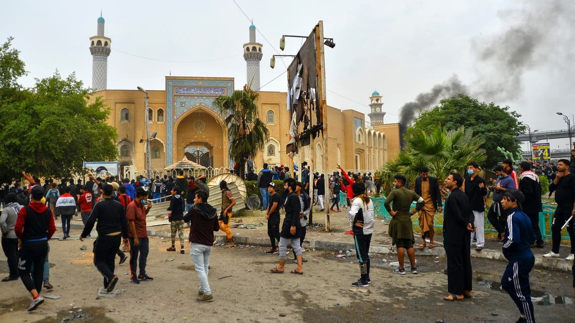Iraqi demonstrators gather in front of the shrine dedicated to the late Iraqi Shiite Ayatollah Mohammed Baqir al-Hakim in the southern Iraqi Shiite holy city of Najaf on December 1, 2019, during anti-government demonstrations. Protesters have hit the streets since early October in the largest grassroots movement Iraq has seen in decades, sparked by fury at poor public services, lack of jobs and widespread government graft. Security forces and armed groups responded with violence to demonstrations, killing more than 420 people and wounding 15,000, according to an AFP tally compiled from medics and an Iraqi rights commission.