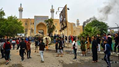 العراق.. اشتباكات بين الأمن والمتظاهرين في النجف