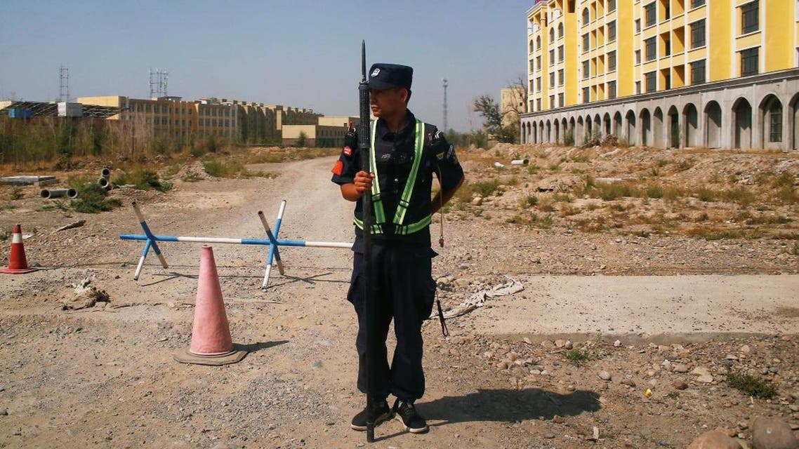 A Chinese police officer takes his position by the road near what is officially called a vocational education center in Yining in Xinjiang Uighur Autonomous Region, China (File photo: Reuters)