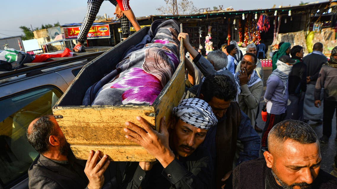 Iraqi mourners carry the coffin of an anti-government protester who was killed in Nasiriyah during clashes between anti-government protesters and security forces, during a funerary procession in the central holy Shiite shrine city of Najaf on November 28, 2019.