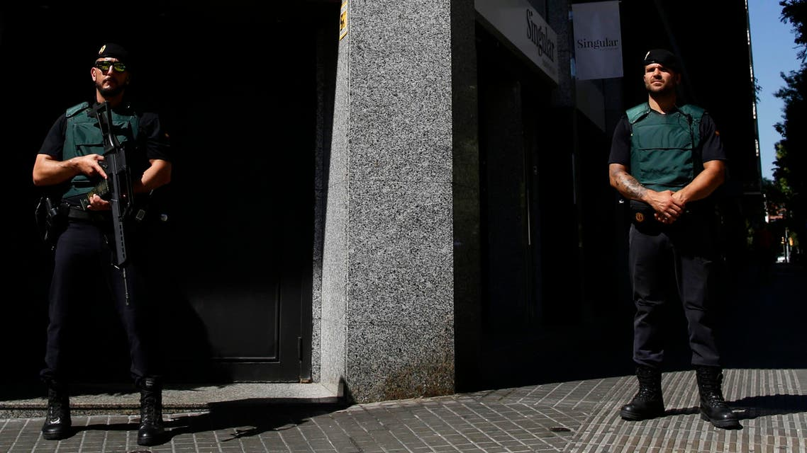 Spanish Guardia Civil members stand during an operation in Barcelona, Spain, Wednesday, July, 5, 2017. Spanish police have arrested 14 people in the northeastern city of Barcelona as part of a European operation against the Camorra organized crime gang. The State prosecutors' office said there were also arrests in Italy and Germany in the Europol-coordinated operation Wednesday against drug trafficking and money laundering. (AP Photo/Manu Fernandez)