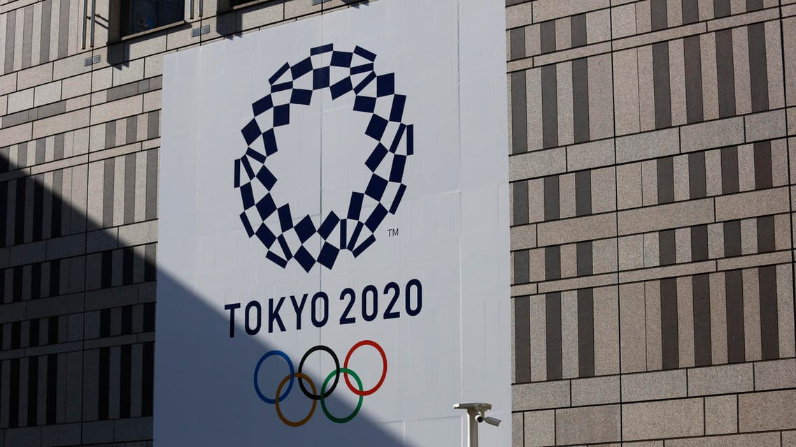 A man walks past a large Tokyo 2020 banner hanging on the facade of the Tokyo Metropolitan Government building Thursday, Nov. 21, 2019, in Tokyo. (AP)