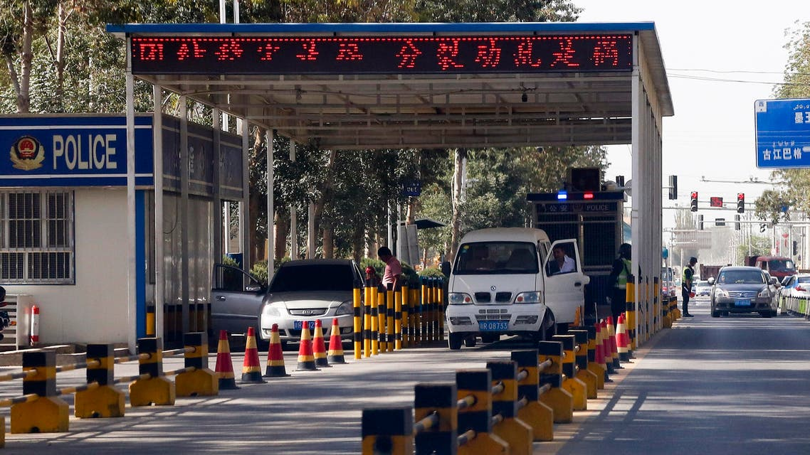 In this Sept. 21, 2018, photo, Uighur drivers have their vehicles checked at a police check point in Hotan, in western China's Xinjiang region. (AP)