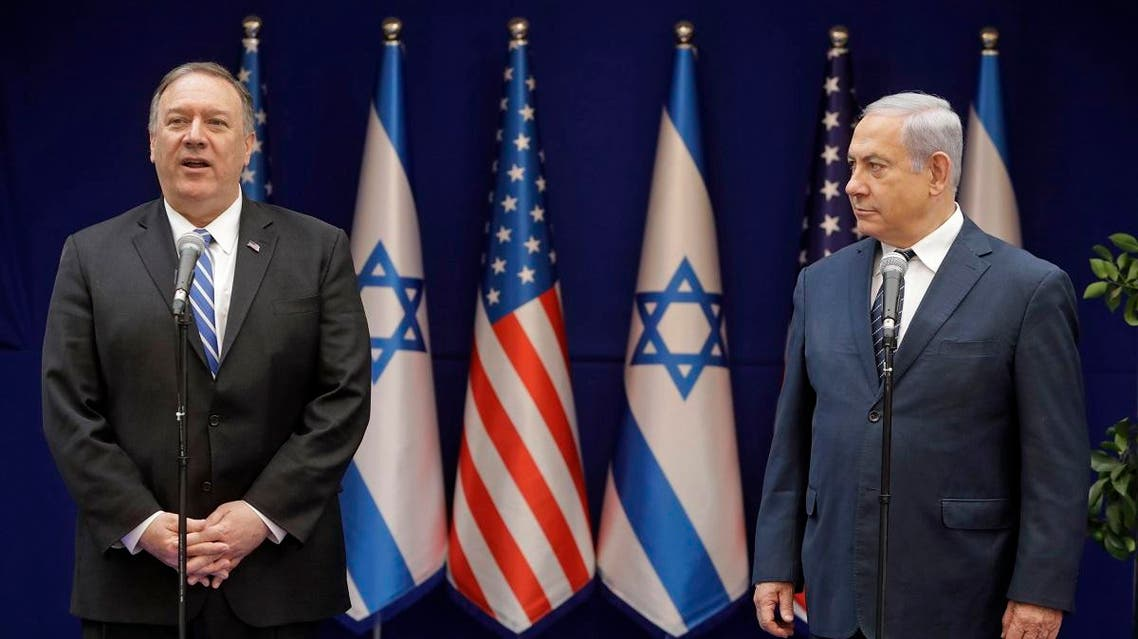 Israeli Prime Minister Benjamin Netanyahu (R) listens to US Secretary of State Mike Pompeo's statement following their meeting in Jerusalem on October 18, 2019. (AFP)