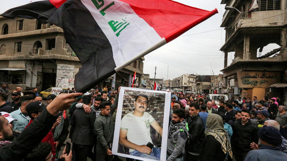 Iraqis mourn a man who died in protests in Baghdad, Dec 3, 2019 - AFP