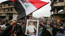 Large numbers protest in Iraq's Tahrir Square as politicians discuss future