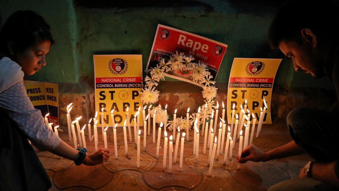 People light candles during a vigil as they attend a protest against the alleged rape and murder of a 27-year-old woman, in Kolkata, India. (Reuters)