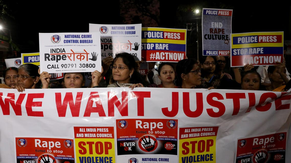 Women display a banner and placards as they attend a protest march against the alleged rape and murder of a 27-year-old woman, in Kolkata, India, December 4, 2019. REUTERS