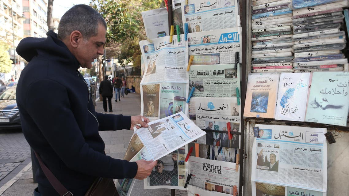 Man reads the last edition of al-mustaqbal, on January 31, 2019, before it went out of print, in Beirut. (Reuters)