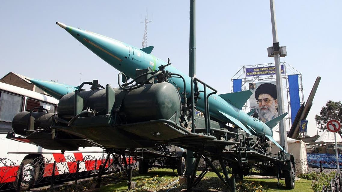 Two Iranian Sayyad-1 surface-to-air missiles (L) and a Zelzal missile (R background) are displayed, 26 September 2007, in front of a large portrait of Iran's Supreme Leader Ayatollah Ali Khamenei. (File photo: AFP)