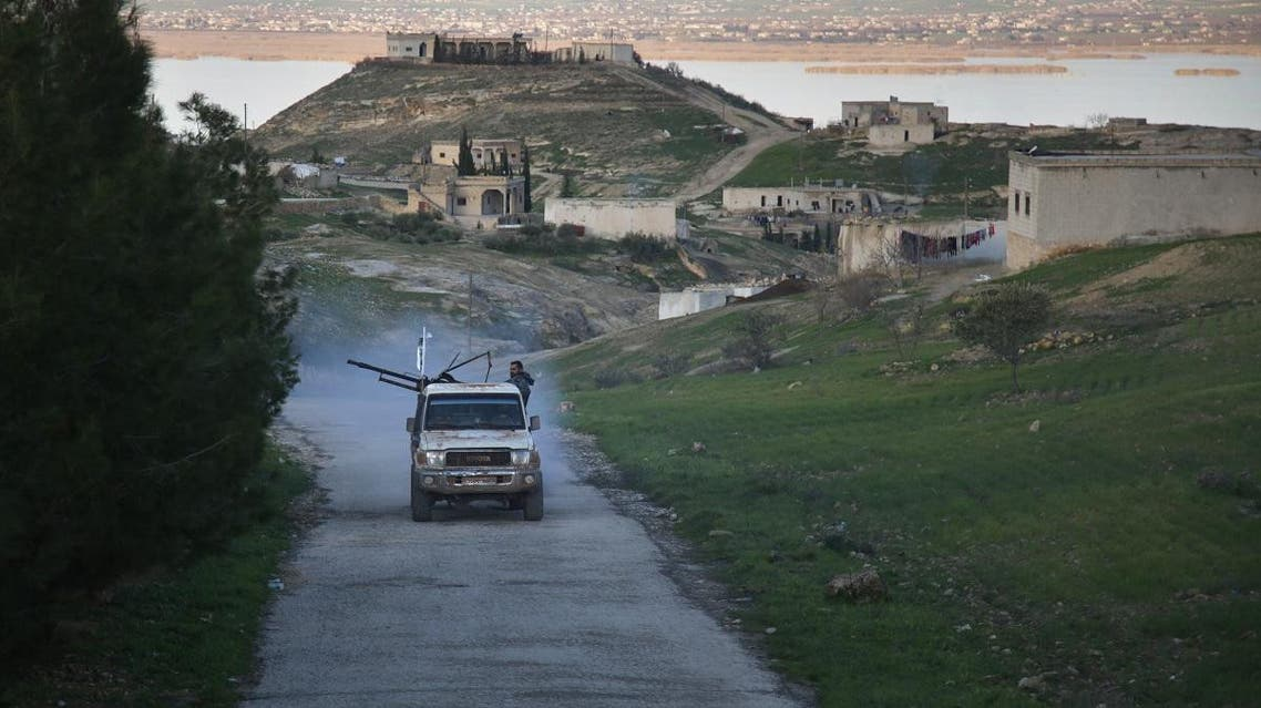 An armed vehicle driven by Turkey-backed Syrian fighters is seen in a village overlooking the Euphrates river near the rebel-held border town of Jarabulus in northern Syria. (File photo: AFP)