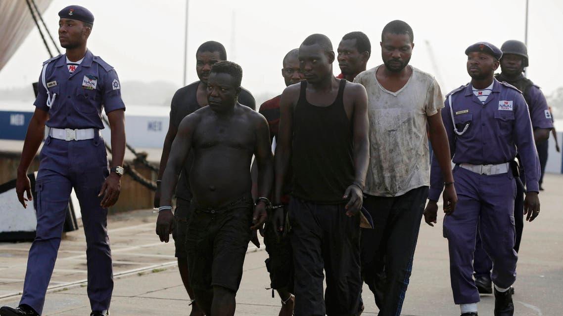 Nigerian pirates under arrest by Nigerian servicemen in 2016 - AP