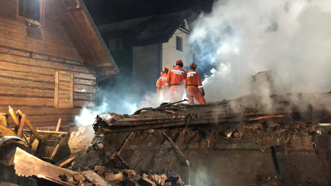 Firefighters work at the site of a building, levelled by a gas explosion, in the ski resort town of Szczyrk, Poland December 5, 2019, in this image obtained from social media. REUTERS