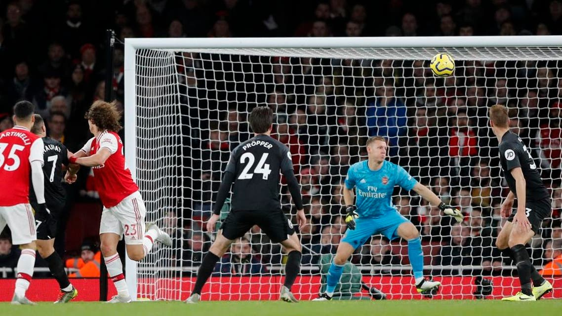 Brighton's Neal Maupay (2nd left), scores his sides second goal past Arsenal's goalkeeper Bernd Leno (2nd right), during their English Premier League soccer match at the Emirates Stadium in London on December 5, 2019. (AP)