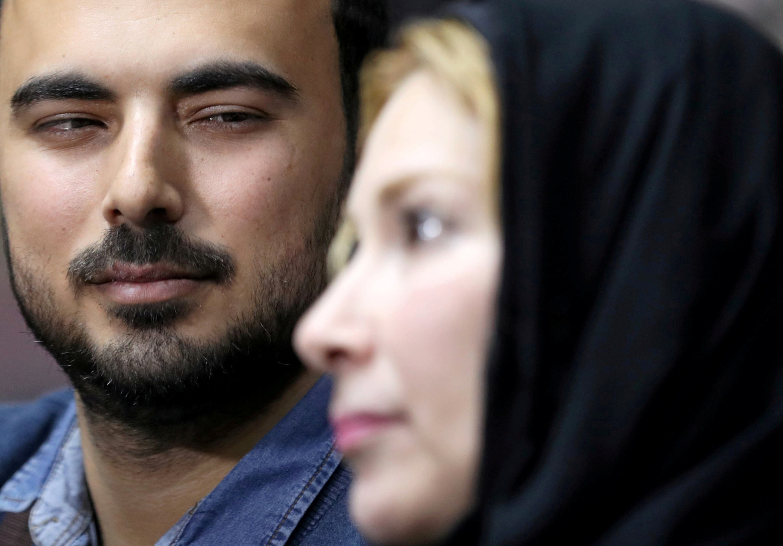 Palestinian journalist, Amjad Yaghi, hugs his mother, Nevine Zouheir, after 20 years of separation, in Banha, Egypt December 2, 2019. Picture taken December 2, 2019. REUTERS