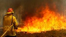 Australia braces for heatwave as more than 100 fires burn