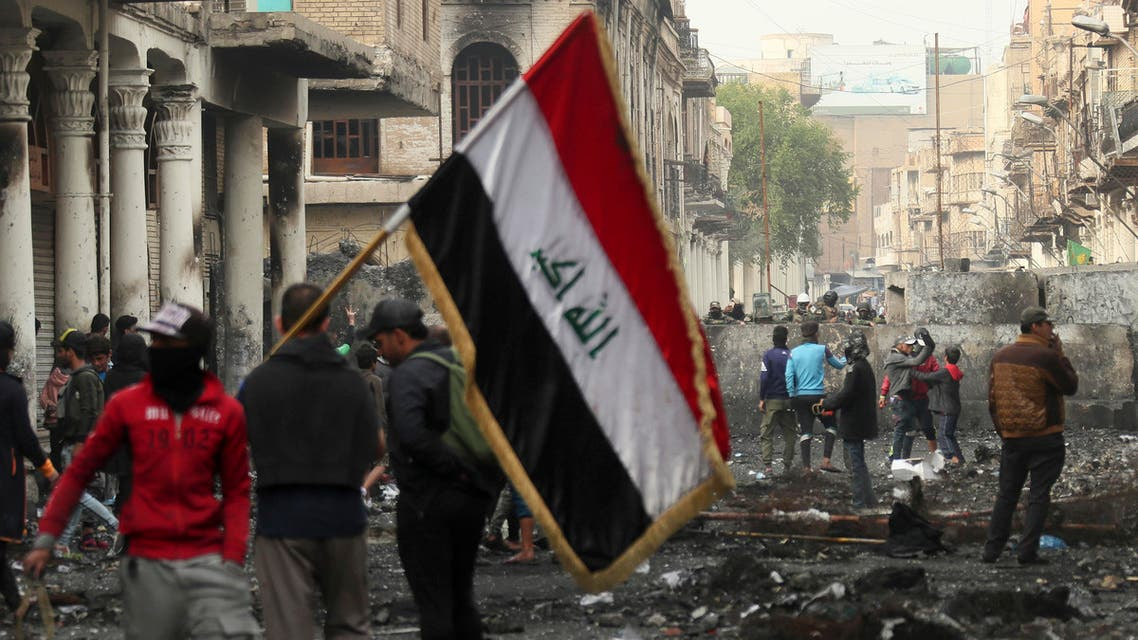 Anti-government protesters gather during clashes with security forces on Rasheed Street in Baghdad, Iraq, Friday, Dec. 6, 2019. (AP)