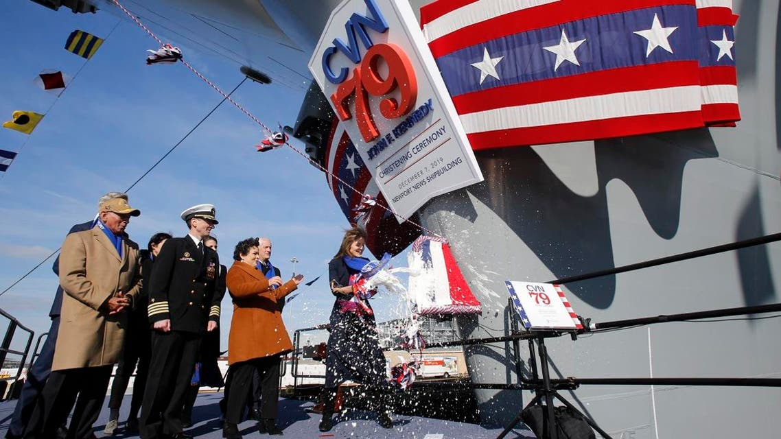 Caroline Kennedy, daughter of former President John F. Kennedy, smashes a bottle on the bow of the ship as she christens of the nuclear aircraft carrier John F. Kennedy at Newport News Shipbuilding in Virginia, on December 7, 2019. (AP)