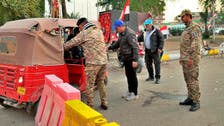 Checkpoints with 'Blue Hats' unarmed militia set up to protect Iraqi protesters