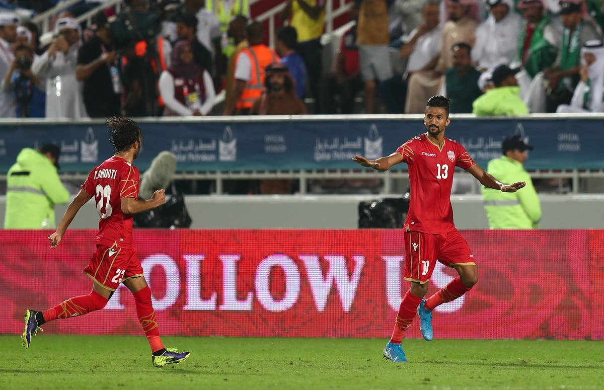 Bahrain's Mohammed al-Rumaihi celebrates scoring their first goal. (Reuters)
