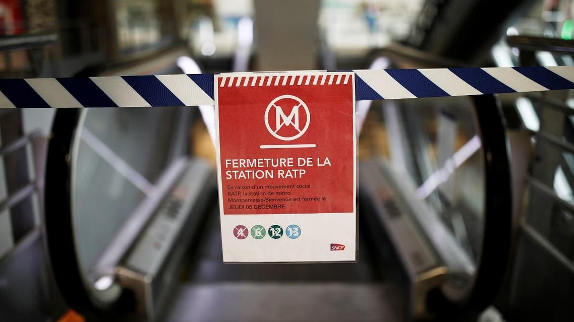 A sign reading metro lines closed is seen at Gare Montparnasse train station as a strike by French SNCF railway and Paris transport network (RATP) workers continues against French government's pensions reform plans. (Reuters)