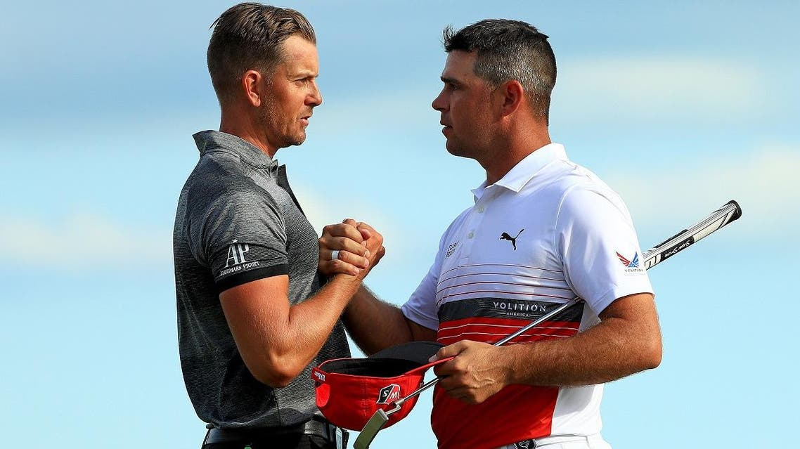 Henrik Stenson of Sweden shakes hands with Gary Woodland of the United States after winning the Hero World Challenge at Albany on December 07, 2019 in Nassau, Bahamas. (AFP)