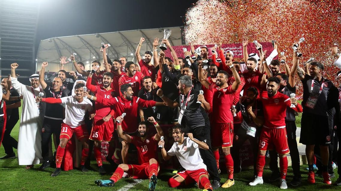Bahrain players and coaching staff celebrate winning the Gulf Cup after the match. (Reuters)