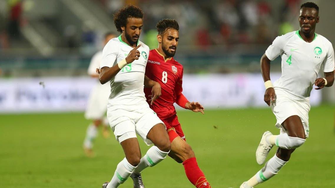 Saudi Arabia's Yasir Al Shahrani in action with Bahrain's Ali Madan. (Reuters)