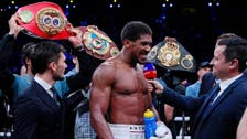 Clash on the Dunes: British challenger Joshua takes back heavyweight titles