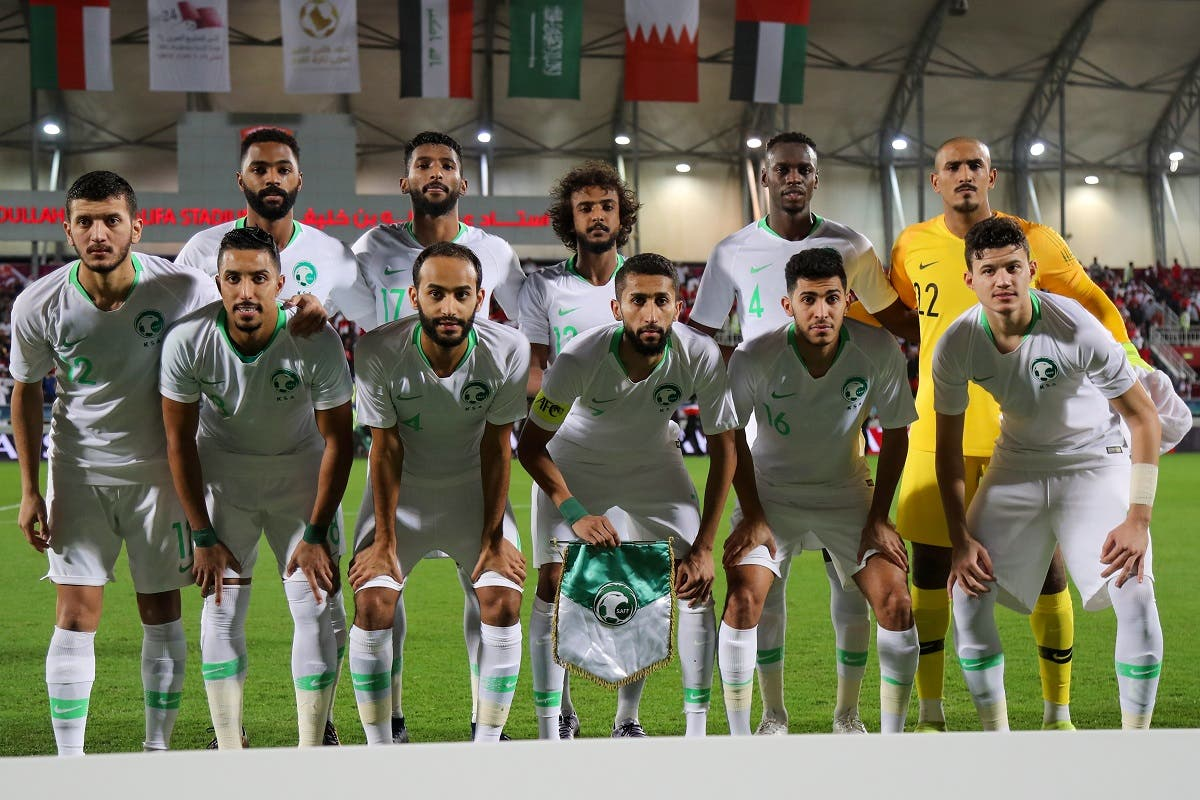 Saudi's starting eleven pose for a group picture during the 24th Arabian Gulf Cup Final football match between Bahrain and Saudi Arabia. (AFP)