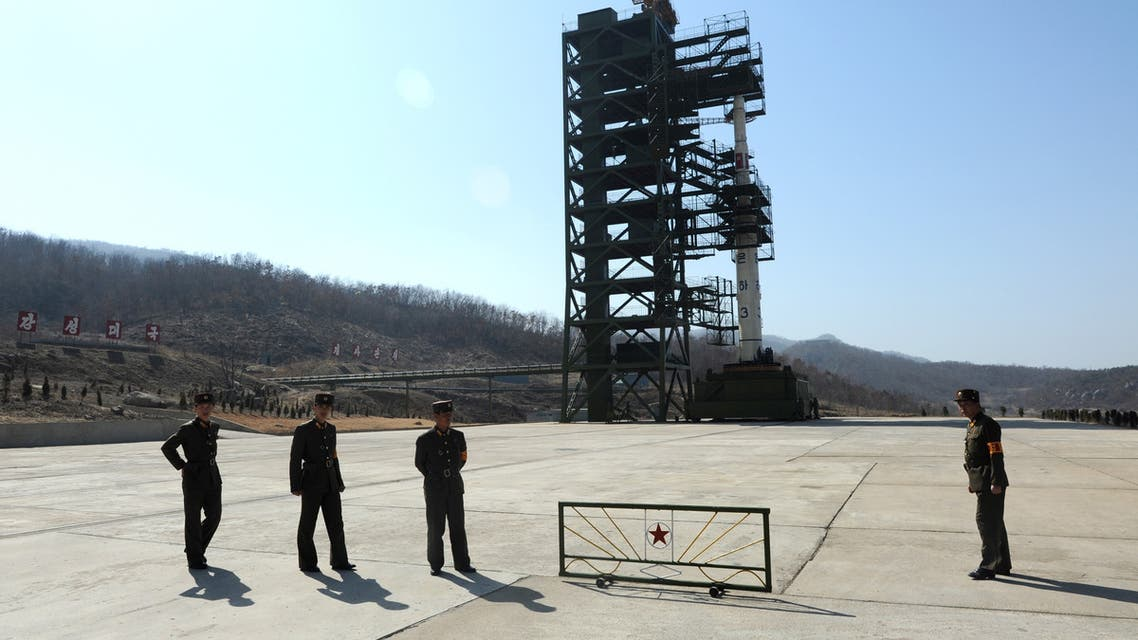 North Korean soldiers stand guard in front of the Unha-3 rocket at the Sohae Satellite Launch Station in Tongchang-Ri on April 8, 2012. North Korea has confirmed their intention to launch the rocket next week despite international condemnations. AFP PHOTO/ Pedro UGARTE