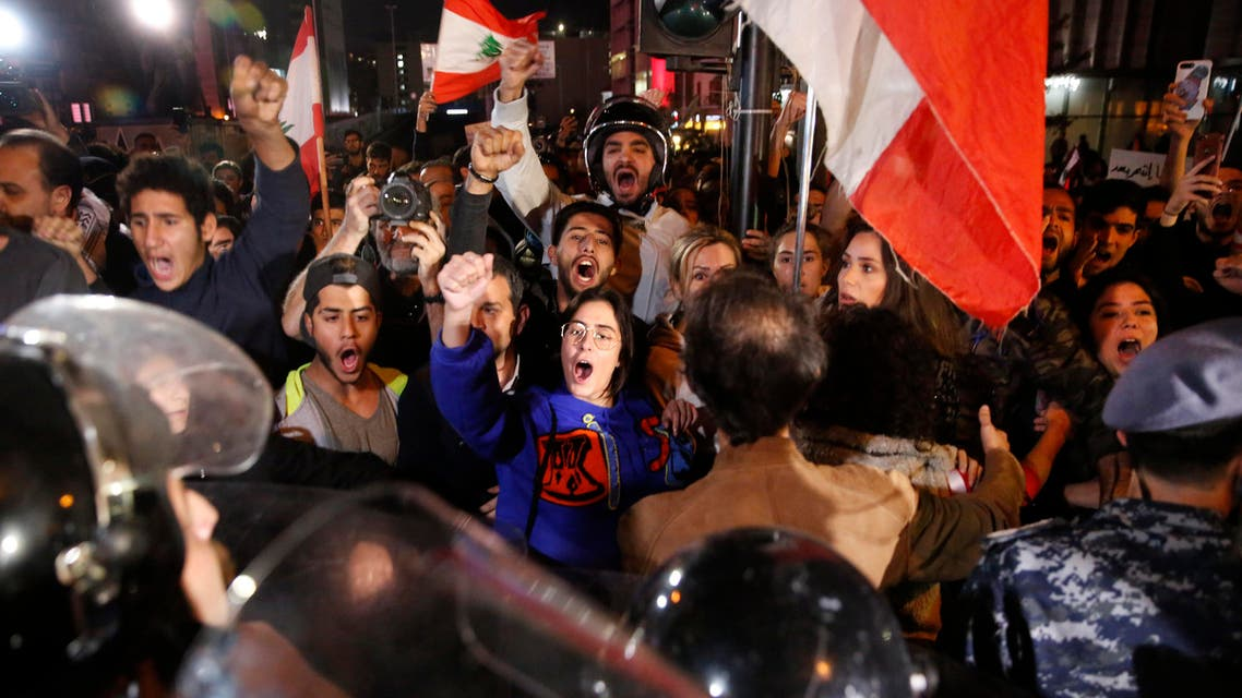 Anti-government protesters shout slogans during ongoing protests against the Lebanese political class and the financial crisis, in Beirut, Lebanon, Wednesday, Dec. 4, 2019 (AP)