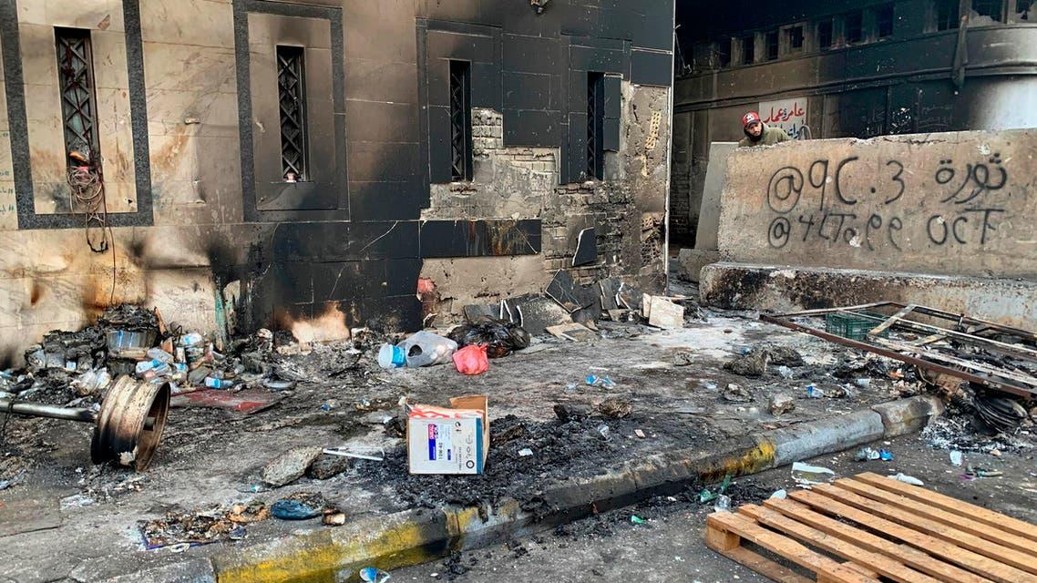 A protester checks the site of a gunmen attack in Baghdad, Iraq, Saturday, Dec. 7, 2019. (AP)