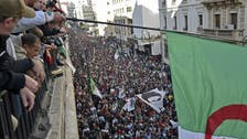 Algerian police disperse students protesting pro-election rally