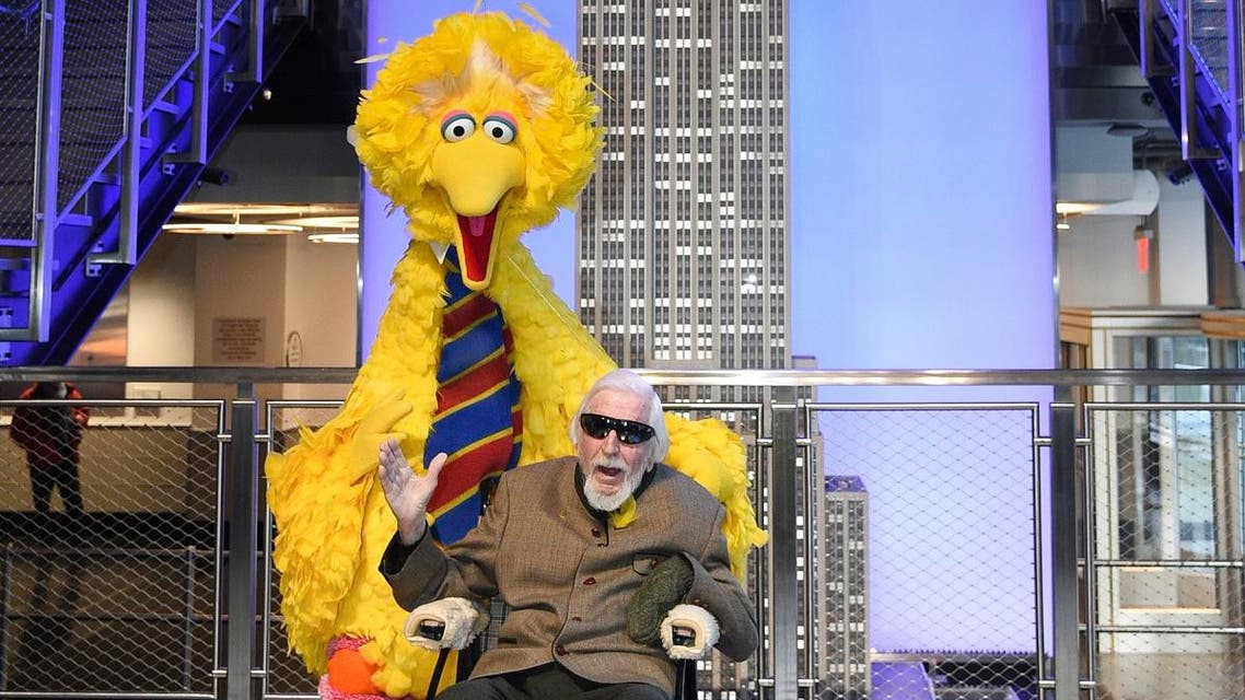 Sesame Street's Big Bird and puppeteer Caroll Spinney participate in the ceremonial lighting of the Empire State Building in honor of Sesame Street's 50th anniversary on Friday, Nov. 8, 2019, in New York. (AP)